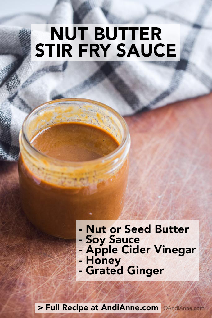 nut butter stir fry sauce on wood cutting board with kitchen towel behind it