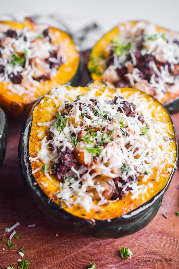 Close up of cooked stuffed acorn squash with grated parmesan on top